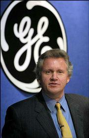 Jeffrey Immelt, General Electric Co. chief executive, announced Friday that the company's fourth-quarter profit rose 18 percent. He cited the impact of acquisitions, strong industrial sales and an excellent global economy. Despite the upbeat earning report, Wall Street finished the day with losses.