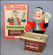 This is the Cragstan Crapshooter, a battery-operated man who chews while he waves his money, shakes his cup, then throws the dice. The 9 1/2-inch toy was made by Yonezawa, a Japanese firm, and sold last fall for $88 at an auction.