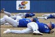 Kansas University pitcher Mike Zagurski, front, stretches before practice. The Jayhawks, who worked out Thursday at Hoglund Ballpark, will open their 2005 season Feb. 4 in Hawaii.