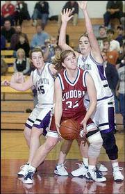 Eudora High's Carrie Lister, center, looks for an opening as Baldwin's Bolby Heckathorne, left, and Katelyn Miles defend. The Cardinals won, 40-35, Thursday in Wellsville.