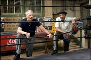 "Clint Eastwood, left, and Morgan Freeman study a fighter from ringside in the drama ""Million Dollar Baby."""