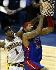Indiana's Stephen Jackson, left, fouls Detroit's Rasheed Wallace. The Pistons defeated the Pacers, 88-76, Thursday night in Indianapolis.