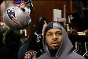 New England running back Kevin Faulk stands in front of his locker. Faulk and the Patriots met the media Thursday in Foxboro, Mass.