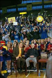 "Allen Fieldhouse was louder than normal Friday morning, with ESPN2&squot;s ""Cold Pizza"" broadcasting live at 7 a.m. Cane Peterson interviewed longtime Kansas University sports broadcaster Max Falkenstien."