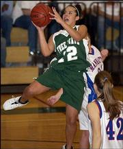 Free State High's Lauren Kimball puts up a shot against Manhattan. The Firebirds lost, 52-36, Friday at Free State.