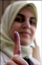 Rasha Abd, an Iraqi immigrant living in Phoenix shows off her dyed finger after voting Friday in Irvine, Calif. Iraqi immigrants living in 14 countries can vote by absentee ballot. Fingerprints were required.