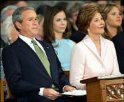 "President Bush attends the presidential inaugural prayer service at Washington&squot;s National Cathedral Jan. 21, 2005 with first lady Laura Bush and daughters Barbara, second from left, and Jenna, right. Seventy-six leaders of evangelical colleges, seminaries and denominations have petitioned Bush about health insurance and the ""unacceptably high"" rates of U.S. hunger and poverty."