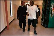 Kansas City (Kan.) Washington High's Darrell Stuckey, left, and his best friend, Grady Henderson, share a laugh in the hallway as they head for the weight room. Stuckey will be among the high school football players who sign letters of intent today with Kansas University.