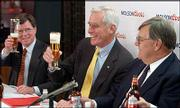 Peter Coors, center, chairman of Adolph Coors Co., shares a toast with Bob Reese, left, chief legal officer, and Leo Kiely, who will serve as president and CEO of Molson Coors, at the Coors Brewery in Golden, Colo. The officials announced the merger of Coors and Molson on Tuesday, the day Coors shareholders approved the $3.4 billion acquisition.