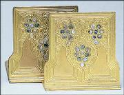 The abalone pattern was one of 15 different designs for desk accessories available from Tiffany between 1900 and 1920. These bookends of gilt bronze with abalone shell insets sold last summer for $3,286. When new in 1920, they cost $28.