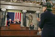 Secretary of State Condoleezza Rice, right, applauds during President Bush's State of the Union speech. Bush gave the first address of his second term Wednesday at the U.S. Capitol.