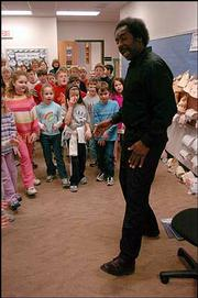 Lemuel Sheppard, of Pittsburg, showed students at Langston Hughes School some steps to an old-time dance, as part of his program about Lewis and Clark and black American history.