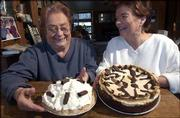 Mary Jane Chubb, left, and her sister Charlene Potter are longtime participants in the Chocolate Auction, a fund-raiser for the arts in Baldwin. Chubb's chocolate pie with whipped cream and Potter's chocolate almond cheesecake will be among the baked goods available at the auction.
