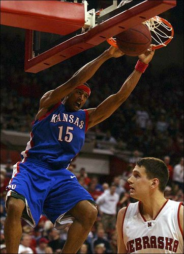 Kansas' J.R. Giddens flushes a dunk against John Turek in the second half. Giddens had just seven points against the Huskers, but was credited with limiting NU freshman phenom Joe McCray to seven points on 2-for-10 shooting.