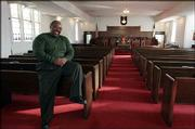 Theodore McVay, Lawrence, is shown in St. Luke AME Church, where he does everything from sing in the choir to take out the trash. A fund-raiser began Saturday to help renovate the church, 900 N.Y.