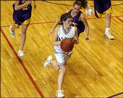 Baldwin's Katie Krysztof pushes the ball upcourt against Spring Hill.