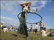 Elizabeth Wrege, of Indianapolis, dances with a hula hoop during last year's Wakarusa Music and Camping Festival. Festival organizers are working with Clinton Lake neighbors and the general public to discuss concerns about this year's festival.