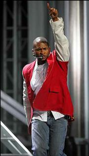 "Usher is nominated for Record of the Year at this year&squot;s Grammys for ""Yeah!"""