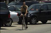 It can be a tough road to pedal when bicyclists have to ride in traffic. Environmentalists such as Boog Highberger on the Lawrence City Commission are pushing to ensure that newly developing areas of town are friendly to pedestrians and bicyclists so residents can walk or ride instead of drive.