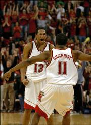 Maryland's John Gilchrist (11) and Chris McCray celebrate their victory. The Terrapins upended seventh-ranked Duke, 99-92, in overtime Saturday in College Park, Md.