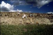 Archaeologists excavate a site in Sherman County, near the Colorado border, which scientists now believe contains the earliest evidence of human existence in the Great Plains. The archaeologists -- including representatives from Kansas University -- have worked on the site the past two summers.
