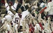South Carolina's Renaldo Balkman celebrates with fans after beating Kentucky. The Gamecocks won, 73-61, Tuesday in Columbia, S.C.