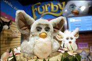 Hasbro Inc.'s Furby boasts a new technology called emotronics that brings the toy more to life. Furby, which can speak interactively with children, is on display at the American International Toy Fair in New York.