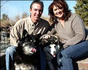 "Doug and Lorele Dittoe of Lincoln, Neb., learned Friday that their dog Murphy, left, had been spared the death sentence by the Nebraska Supreme Court. The Dittoes have been waiting nearly four years for the decision after Murphy fought with a neighbor's dog in 2001. Also pictured with the Dittoes is their other dog, Chloe, right. After Friday's decision, they were planning a party with Murphy. ""She might just get a steak,"" Lorele Dittoe said."