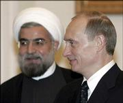 Iranian National Security Council chief Hasan Rohani meets with Russian President Vladimir Putin at the Kremlin. Putin said Friday that he was convinced Iran did not intend to develop nuclear weapons and that he planned to visit Iran.