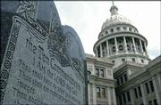 This 5-foot-tall stone slab bearing the Ten Commandments stands near the Texas Capitol in Austin, Texas. On March 2, the Supreme Court will hear arguments in a federal lawsuit seeking to remove this monument and one at a Kentucky courthouse on grounds that they violate constitutional separation of church and state.