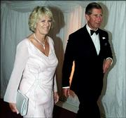 Britain's Prince Charles, right, and Camilla Parker Bowles walk to the gala dinner at The Prince's Foundation in London on June 20, 2000. Questions over their planned marriage are pulling at Anglican unity.