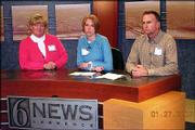 2005 Lawrence Leadership class members, from left, Jane Blocher, Lynn Parman and Scott McMichael practice their broadcasting skills at 6News. They participated in Civic Roles and Media Day on Jan. 27 at The World Company.