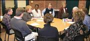 Kim Bodensteiner, third from left, speaks during a media session for the 2005 Leadership Lawrence class. Other class members, pictured clockwise around the table from Bodensteiner, are Ndeye Ceesay, Kevin Boatright, Hank Booth, Doug Gaumer, Maria Martin, Kiersten Gens, Jamie Lowe and Brad Chindamo. The class met Jan. 27 at the News Center. Pictured in back at right is Charlene Droste, session coordinator.
