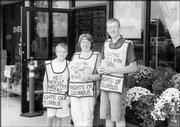 From left, Drew Fox, 11, Beth Fox and Johnathan Fox, 14, participate in the Knights of Columbus Council 1372 Tootsie Roll Drive Oct. 8-10 at Wal-Mart in Lawrence. The fund-raiser benefitted special Olympics, Cottonwood Inc. and ARC of Douglas County.