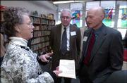 From left, Carolyn Landgrebe, retired teacher from Riverside and New York schools, visits with Pete Curran and Judge James Paddock, both trustees with the Ethel and Raymond Rice Foundation, at the new library at East Heights Early Childhood Family Center. The Lawrence Schools Foundation obtained funding for the library with a $59,000 grant from the foundation.