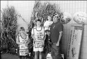 From left are Jessica Nau, Jennifer Anderson and Christopher Nau being held by his father, Tom Nau. They participated in the Knights of Columbus Council 1372 Tootsie Roll Drive Oct. 8-10 at Westlake Hardware.
