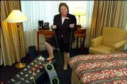 Jenny Botero, Residence Manager at Marriott Crystal Gateway Hotel, displays the in-room fitness equipment in a room at the hotel in Arlington, Va. The exercise equipment is delivered to the room on request of the hotel guest.