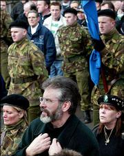 Sinn Fein President Gerry Adams attends an Irish Republican Army commemoration Sunday in Strabane, Northern Ireland. In an unprecedented charge, the Irish government Sunday publicly identified three of Sinn Fein's top figures, including Adams, as members of the Irish Republican Army command.