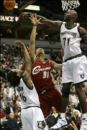 Minnesota forward Kevin Garnett (21) rejects a shot attempt by Cleveland forward Drew Gooden (90) as Timberwolves guard Troy Hudson (16) defends. The Timberwolves, who defeated the Cavaliers, 94-88, Thursday in Minneapolis, could be active this week as the NBA trade deadline approaches.