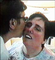 Terri Schiavo, right, gets a kiss from her mother, Mary Schindler, in this Aug. 11, 2001, image taken a from videotape. Schiavo's husband is expected to be allowed to remove her feeding tube today.