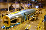 A fuselage section of the final Boeing 757 is shown in the Boeing Co.'s manufacturing plant in Wichita in this August 2004 file photo. Boeing Co. on Tuesday sold its commercial aircraft plants in Kansas and Oklahoma to a Toronto-based investment group, Onex Corp.