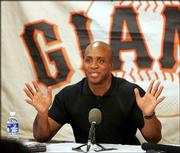San Francisco's Barry Bonds meets the media. Bonds spoke Tuesday in Scottsdale, Ariz., during his first day in training camp.