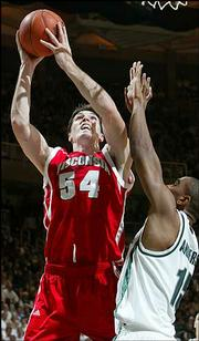 Wisconsin's Mike Wilkerson (54) shoots over Michigan State's Alan Anderson. Anderson had 28 points, and MSU won, 77-64, Thursday night in East Lansing, Mich.