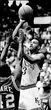 Terry Brown, who drained a school-record 11 three-pointers in 1991, lets fly a shot.