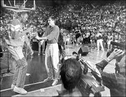 Danny Manning, left, and Scooter Barry take part in a Late Night With Larry Brown skit in 1987.