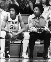 Kansas standout Lynette Woodard, left, and then-coach Marian Washington sit on the KU bench. Woodard holds the women's record for points scored in a fieldhouse game -- 44.