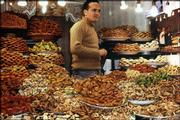 A Moroccan man displays heaping trays of fresh pastries in a souk (marketplace) in one of the cities recently visited by Dave and Gunda Hiebert, of Lawrence.