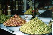 "Heaping bowls of olives are displayed at a Moroccan souk (market). Lawrence couple Dave and Gunda Hiebert traveled to the North African country recently and brought back a love for ""the succulent cuisine and the exoticism of the whole country."""