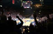 "Kansas University fans are silhouetted against the Kansas University/Texas game Jan. 29 at Allen Fieldhouse. KU is celebrating the fieldhouse&squot;s 50th ""birthday"" this week."