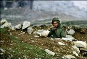 A Syrian soldier patrols a hilltop in the central mountains near the village of Falougah, east of Beirut, Lebanon. In a speech to his country's parliament today, Syrian President Bashar Assad is expected to announce a redeployment of troops to eastern Lebanon, near the Syrian border. Syrian troops first entered Lebanon in 1976 and were backed by the Arab League as a peacekeeping force in the country's 1975-1990 civil war.
